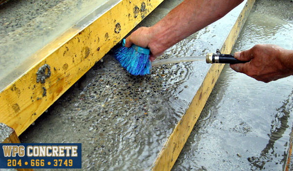 Washing exposed aggregate concrete in Winnipeg, Manitoba