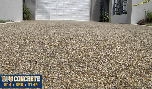 Completed exposed aggregate concrete sidewalk in Winnipeg, Manitoba