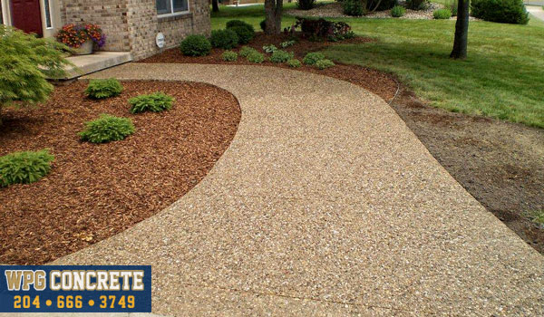 Completed exposed aggregate concrete driveway in Winnipeg, Manitoba
