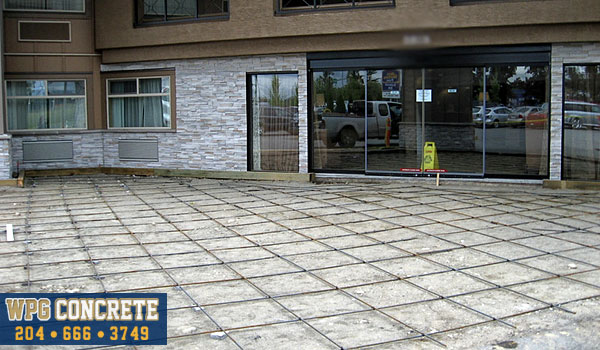Rebar reinforcements in place for stamped concrete in Winnipeg, Manitoba